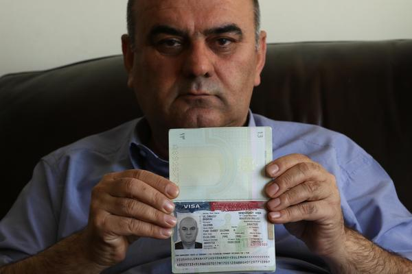 Fuad Sharif Suleman shows his U.S. immigrant visa in Irbil, Iraq, on Jan. 30, after returning to Iraq from Egypt, where he and his family were prevented from boarding a plane to the U.S. following President Trump's decision to temporarily bar travelers from seven countries, including Iraq.