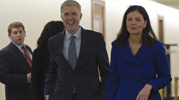 Supreme Court nominee Judge Neil Gorsuch (center) arrives with former New Hampshire Sen. Kelly Ayotte on Capitol Hill last week for a meeting with Sen. Bob Corker, R-Tenn. There are different kinds of conservative judges, from the pragmatist to the originalist. Gorsuch is a self-proclaimed originalist.