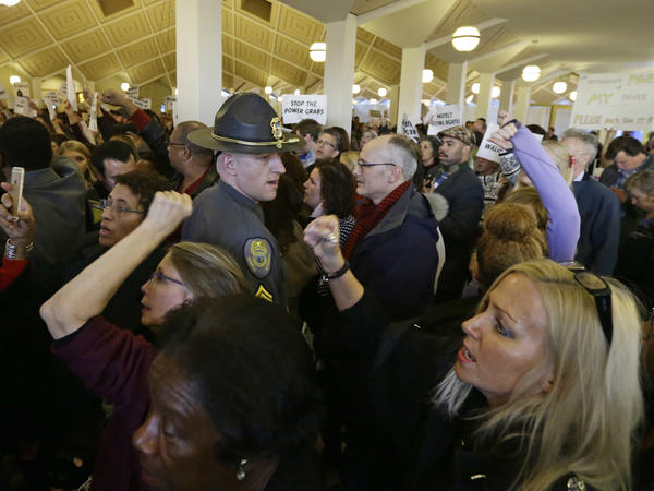 Demonstrators at the state Legislature building in Raleigh, N.C., on Dec. 15, 2016, during a special session to pass laws limiting the power of the state's new governor, Roy Cooper.