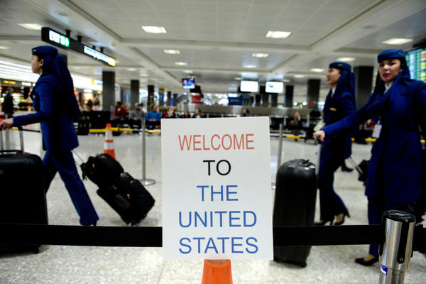A sign at Washington Dulles International Airport welcomes travelers. A three-judge panel decided not to reinstate President Trump's travel ban barring travelers from seven majority-Muslim nations.