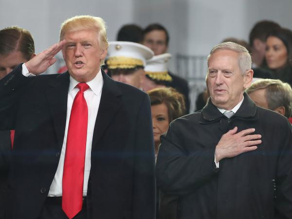 President Trump stands with Defense Secretary James Mattis as a parade passes a reviewing stand in front of the White House last month.