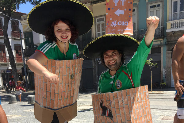 Brazilian journalists Luciana (left) and Fernando Miragaya are dressed as President Trump's Mexican Wall.