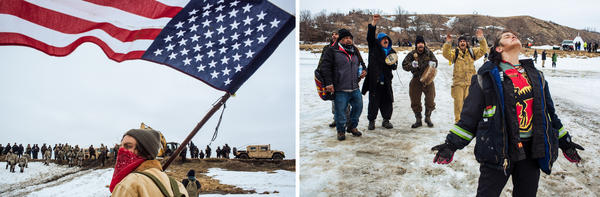 Protestors stand on the Cannonball River as police secure the northern bank after they cleared the Oceti Sakowin camp.