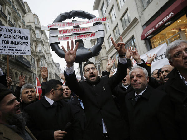 Supporters of Turkey's President Recep Tayyip Erdogan walk to the Dutch consulate in Istanbul on Saturday. Turkey and the Netherlands escalated their spat on Saturday as the Dutch withdrew landing permission for the Turkish foreign minister's plane.