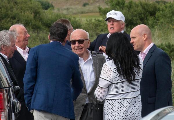 Candidate Donald Trump and media magnate Rupert Murdoch (center) at Trump International Golf Links in Aberdeen, Scotland, last June.