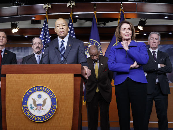Top House Democrats, including Rep. Elijah Cummings, D-Md. (at the podium), said this week they want an investigation into President Trump's connections with Russia, such as when he learned that his national security adviser, Michael Flynn, had discussed U.S. sanctions with a Russian diplomat.