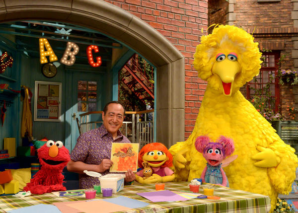 """Julia (center) first appeared online and in printed materials as a part of <em>Sesame Street</em>'s<a href=""""http://autism.sesamestreet.org/storybook-we-are-amazing/"""" target=""""_blank""""> See Amazing in all Children</a> initiative. She'll now appear on TV as well. From left, Elmo, Alan Muraoka, Julia, Abby Cadabby and Big Bird."""