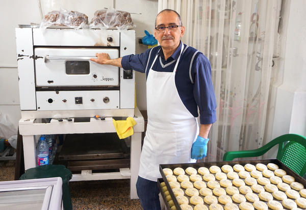 Owner of Helwayat Al-Salam, Mitri Hanna Moussa. Mitri's family has been making <em>maamoul</em> for decades – even before they had an oven to bake them in.