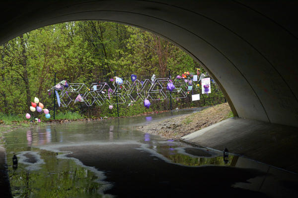 Flowers, balloons, and other tributes left by fans hang on the fence outside Paisley Park, Prince's home and studio, in Chanhassen, Minn., in April 2016. The prolific musician died on April 21, 2016 at age 57.