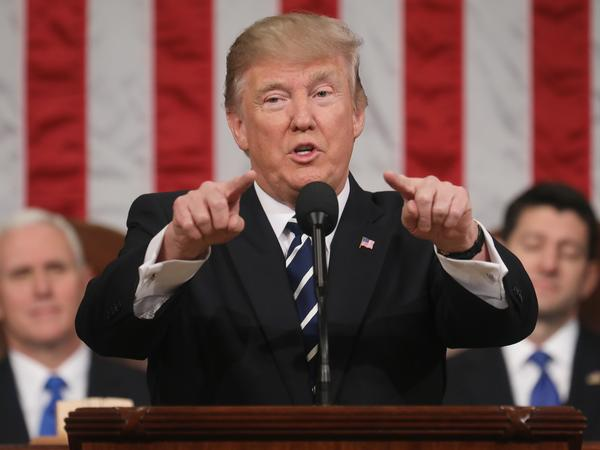 President Donald J. Trump (C) delivers his first address to a joint session of the U.S. Congress as U.S. Vice President Mike Pence (L) and Speaker of the House Paul Ryan (R) listen on February 28, 2017, in the House chamber of the U.S. Capitol in Washington, D.C.
