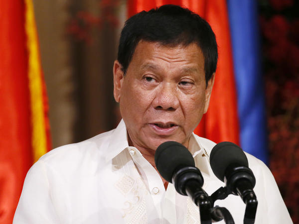Philippine President Rodrigo Duterte talks with reporters in Manila on Friday. President Donald Trump invited Duterte to the White House in a phone call this weekend, despite concerns about the leader's violent war on drugs.