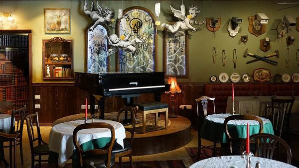 The piano bar at Banksy's Walled Off Hotel is themed as a colonial outpost from Palestine in 1917.