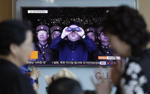 "North Korean leader Kim Jong Un is shown on a TV at the Seoul Railway Station in South Korea on Sunday, when North Korea test-launched a ""medium long-range"" missile that landed in the waters between Japan and the Korean Peninsula."