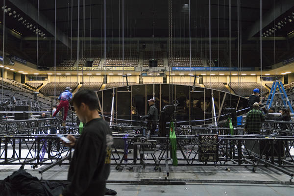 Members of the crew work on the grid, a massive aluminum structure that will eventually be hoisted 40 feet into the air.