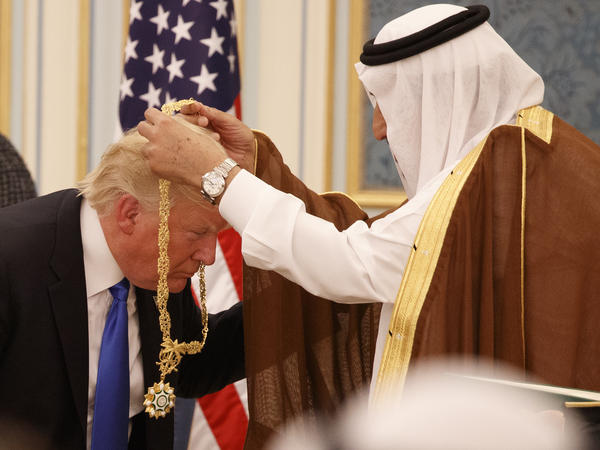 Saudi King Salman presents President Trump with The Collar of Abdulaziz Al Saud Medal at the Royal Court Palace on Saturday in Riyadh.