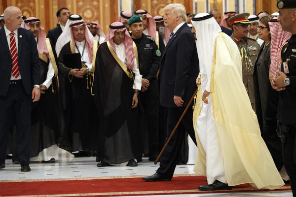 Saudi King Salman (second right), walks with U.S. President Donald Trump on Sunday to attend the Arab Islamic American Summit in Riyadh, Saudi Arabia.