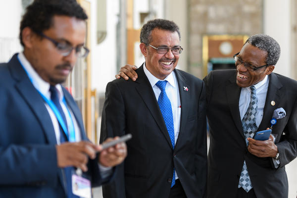 Ethiopia's Tedros Adhanom Ghebreyesus, center, after his speech to delegates at the World Health Assembly on May 23 in Geneva.