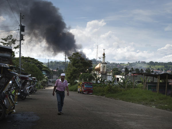 Smoke billows from the Marawi city center after an air attack by Philippine government troops on May 30. Philippine government troops have been battling ISIS-linked militants.
