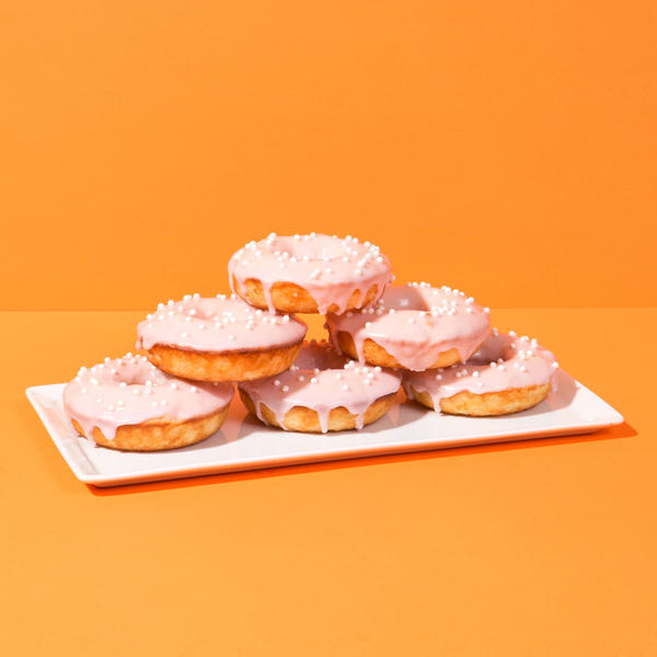 Baked crema Mexicana doughnuts with a blood orange glaze, as featured in the food blog Chicano Eats. On his bilingual blog, Esteban Castillo shares traditional and fusion Mexican recipes. The blog has a stunning, minimalist aesthetic meant to challenge the way people see Mexican food.