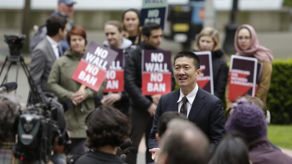 Hawaii Attorney General Doug Chin speaks to media outside the 9th Circuit U.S. Court of Appeals in Seattle on May 15. The court has largely upheld a preliminary injunction blocking President Trump's travel ban from going into effect.