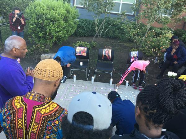 Friends, family and activists gathered for a vigil Sunday outside the apartment building where Charleena Lyles was killed earlier that day.