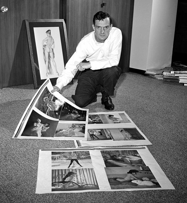 Hefner looks over proof sheets for <em>Playboy</em> in 1961 in Chicago.