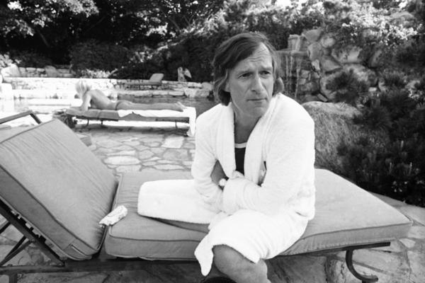 Hefner lounges in the backyard of his Los Angeles mansion in 1975.