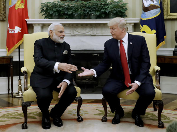 President Donald Trump and Indian Prime Minister Narendra Modi reach to shake hands during their meeting in the Oval Office on Monday. Concerns in New Delhi have centered on whether India will remain a priority relationship for the U.S.