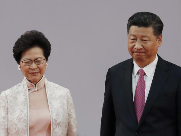 Chinese President Xi Jinping, right, and Hong Kong's new Chief Executive Carrie Lam leave after administering the oath for a five-year term in office at the Hong Kong Convention and Exhibition Center in Hong Kong Saturday, July 1, 2017.