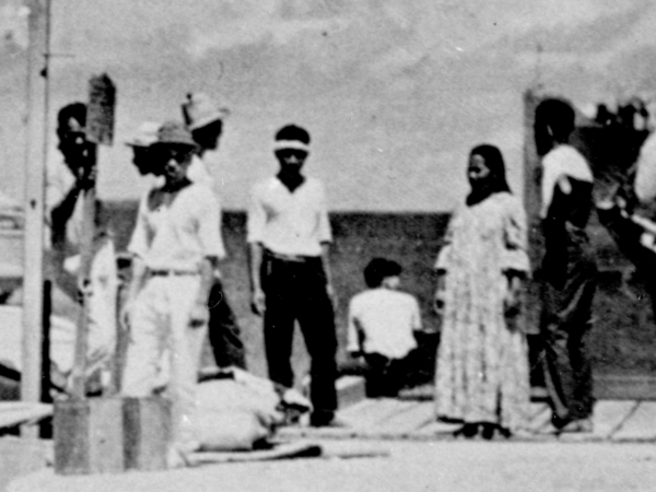 A closer look at a recently unearthed photo shows a short-haired figure who could be aviator Amelia Earhart.