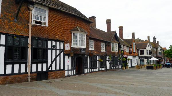 The George Hotel, a 17th century stagecoach inn, is one of the few historic buildings on Crawley's main street. Most of the town was built after World War II to house people displaced by bombing in London. In recent years, immigrants settled in Crawley and work at Gatwick Airport nearby.