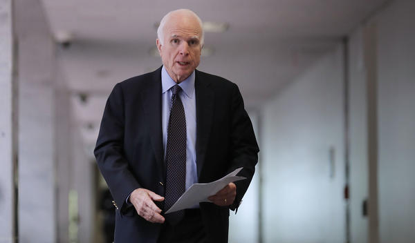 Senate Intelligence Committee member Sen. John McCain, R-Ariz., heads into a closed-door committee meeting with Director of National Intelligence Dan Coats on June 15 in Washington, D.C.