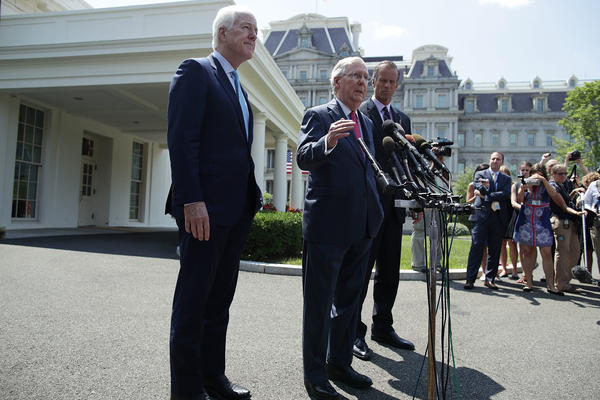 Senate Majority Leader Mitch McConnell, R-Ky. (center), speaks to members of the media with Senate Majority Whip John Cornyn, R-Texas, (left) and Sen. John Thune, R-S.D., outside the West Wing of the White House after a lunch meeting with President Trump on Wednesday.
