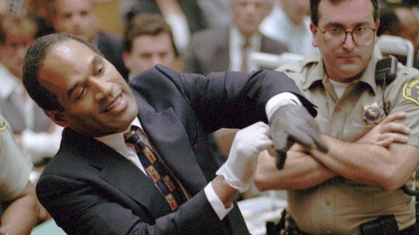 Murder defendant O.J. Simpson grimaces in July 1995 as he tries on one of the leather gloves prosecutors say he wore the night his ex-wife Nicole Brown Simpson and Ron Goldman were murdered. The   trial transfixed the nation with a tale of a football hero turned accused murderer.