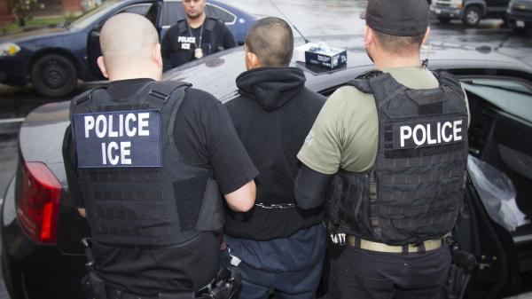 """In this February photo released by U.S. Immigration and Customs Enforcement, agents arrest foreign nationals. According to a Massachusetts Supreme Judicial Court ruling Monday, local law enforcement cannot honor ICE """"detainers,"""" which request that a person remain in custody who would otherwise be released."""