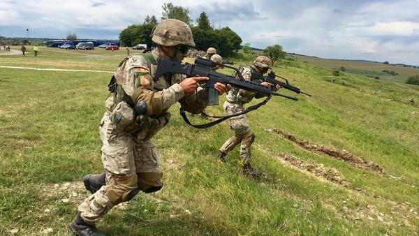 U.S. Army troops from the 4th infantry brigade charge during live-fire exercises at Cincu training grounds in Romania.