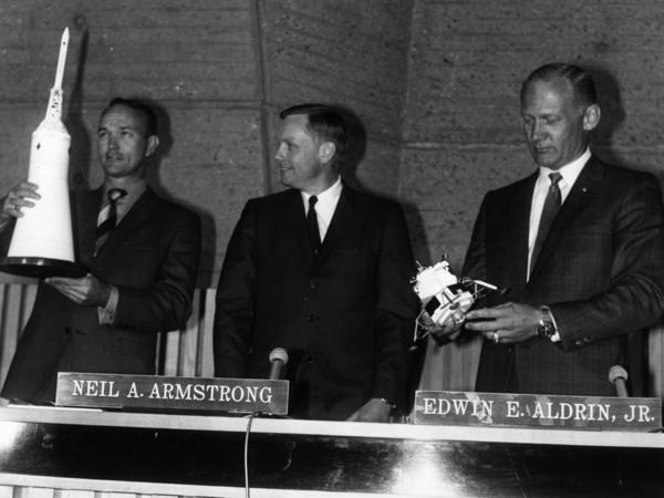 From left: Michael Collins, Neil Armstrong and Buzz Aldrin in Paris in 1969. Aldrin holds a lunar module model of similar size and shape to the gold one stolen Friday.