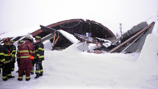Emergency crews attend to the scene of the partially collapsed roof of the Rostraver Ice Garden on Feb. 14, 2010.