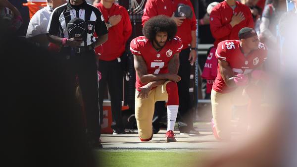 Colin Kaepernick kneels for the national anthem before a game last October in Santa Clara, Calif.