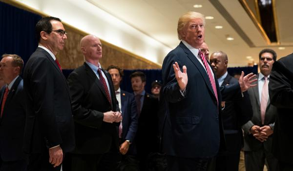 President Trump speaks to reporters in Trump Tower in New York City on Tuesday.