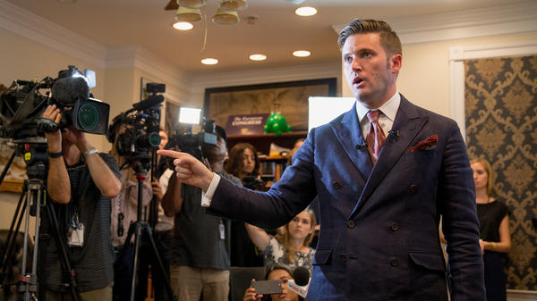 White nationalist Richard Spencer speaks to journalists Monday in Alexandria, Va., just days after three people died amid violence at rallies Spencer attended in Charlottesville, Va.