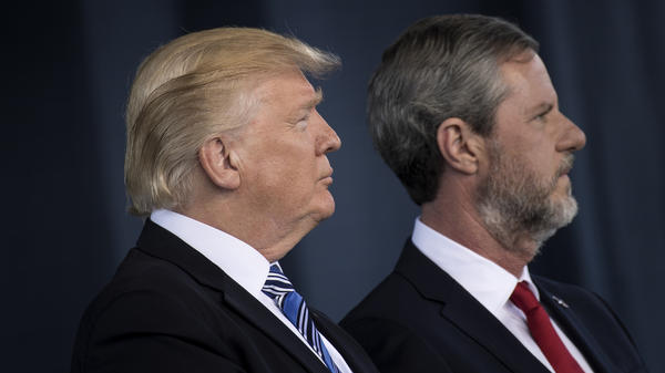 """Liberty University Presidnet Jerry Falwell, Jr., right, praised President Trump for his """"bold truthful statement"""" about Charlottesville."""