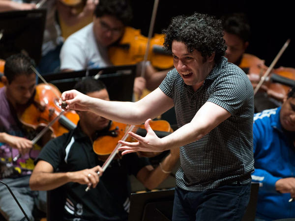 Venezuelan conductor Gustavo Dudamel leads the Simon Bolivar National Youth Orchestra during a rehearsal in Caracas on November 20, 2012.