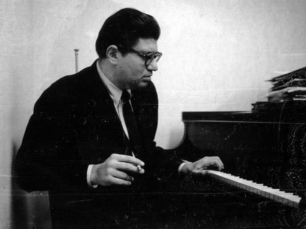 Composer Morton Feldman at the piano, ca. 1963.