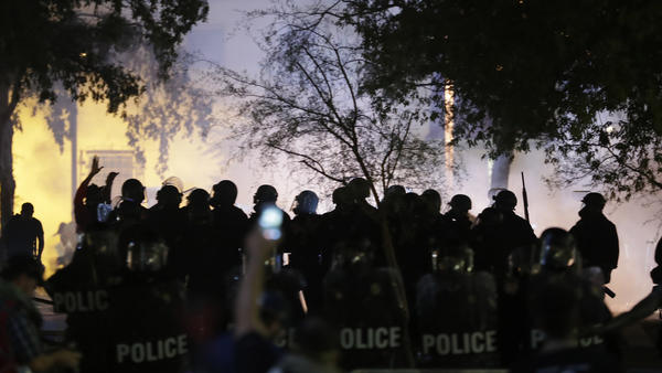 Phoenix police move protesters away after using tear gas outside the Phoenix Convention Center, where President Trump hosted a rally, earlier this week.