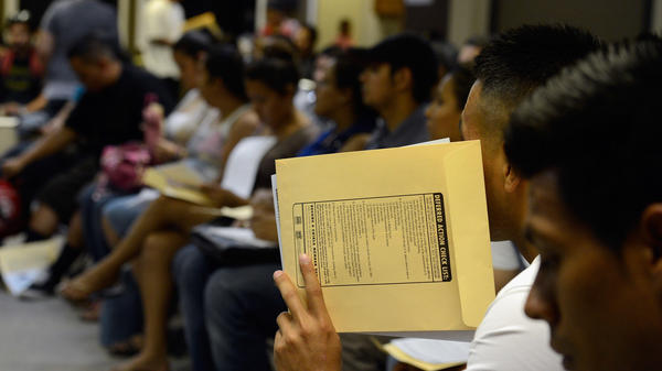 People at the Coalition for Humane Immigrant Rights of Los Angeles attend an August 2012 orientation class for filling out their application for the Deferred Action for Childhood Arrivals program.