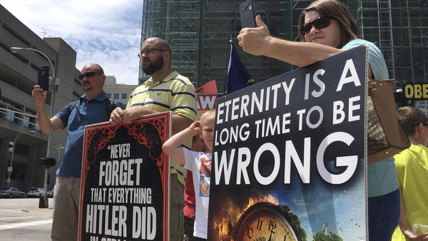 """Abortion rights opponents gather during a rally in downtown Louisville earlier this summer. A federal judge issued an order to keep protesters away from a """"buffer zone"""" outside the EMW Women's Surgical Center."""