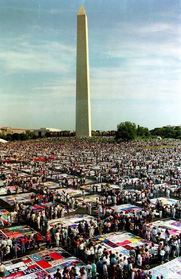 Thousands of people gather to view the AIDS Memorial Quilt on display on the Washington Monument grounds on Oct. 10, 1992. The quilt contains more than 20,000 panels with the names of people who have died of AIDS.