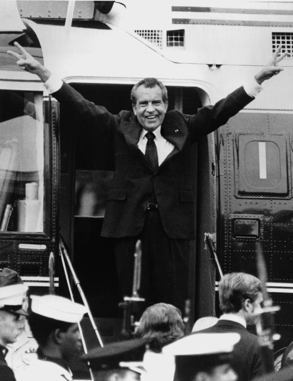 Richard Nixon says goodbye to his staff members outside the White House as he boards a helicopter after resigning the presidency on Aug. 9, 1974.