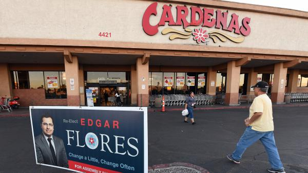 Latinos outside Cardenas market in Las Vegas are hesitant to talk politics today because they feel that they are targeted by the government.